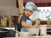 small chef boy baking cake
